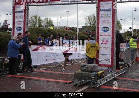 Sunderland, UK. 04th May, 2014. Winner of the 2014 Sunderland Half Marathon crossing the finishing line,Sunderland, Tyne and Wear. May 4th 2014. Credit:  Kensplace/Alamy Live News - Stock Image
