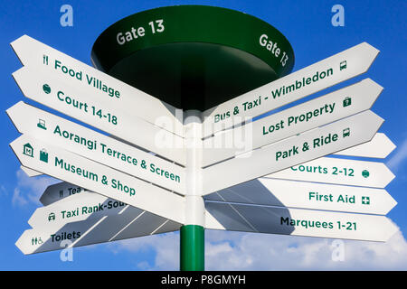Visitor information sign and directions with guidance to courts at Wimbledon Championships 2018, All England Lawn Tennis Club, London, UK - Stock Image