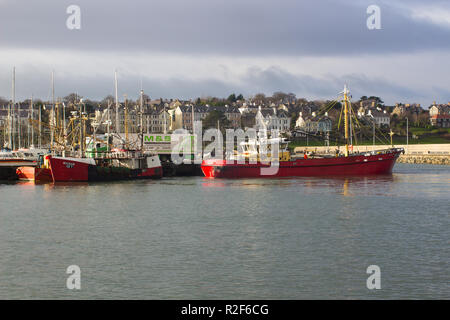 The trawler Maria Lena of Kilkeel manoeuvres to her berth in the harbor in Bangor Northern Ireland on a pleasant winter's day - Stock Image