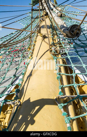 Yellow bowsprit of square-rigged ships Mir (Peace) in Russian, Tall Ships Race Lisbon 2016 - Stock Image