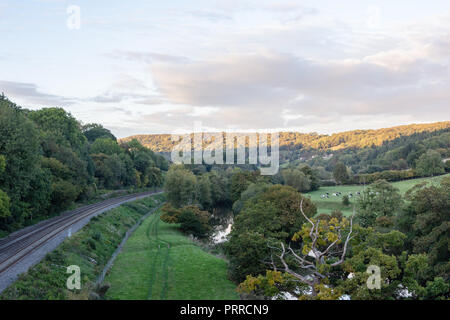 An autumn evening view of the Avon valley running towards the city of Bath from the Dundas Aqueduct in the late evening sun - Stock Image