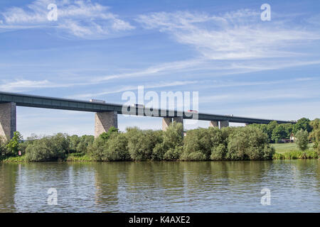 Lorry Trucks Cross The Busy Highway Bridge Near Regensburg, Which Runs Across The Danube - Stock Image