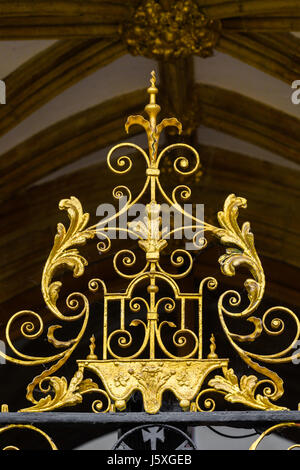 Gilded metalwork above the entracne door at the west facade of the medieval christian cathedral at Peterborough, - Stock Image