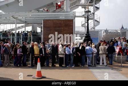 Queue at the London Eye - Stock Image