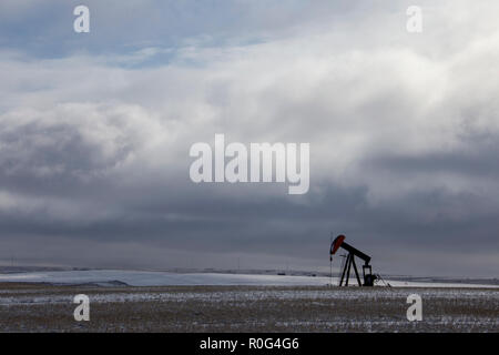 Oil Jack in Winter in Saskatchewan Canada - Stock Image