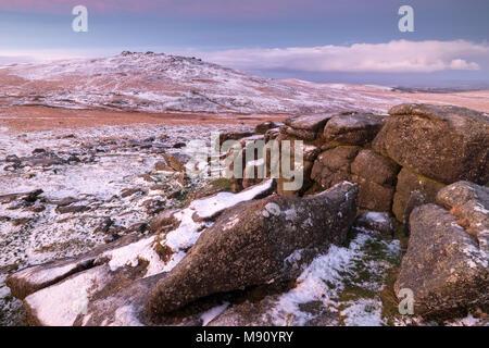 West Mill Tor from Rowtor in winter snow, Dartmoor National Park, Devon, England. Winter (December) 2017. - Stock Image
