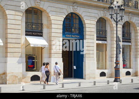PARIS, FRANCE - JULY 07, 2018: Louis Vuitton store in place Vendome in Paris, people passing in a sunny summer day - Stock Image