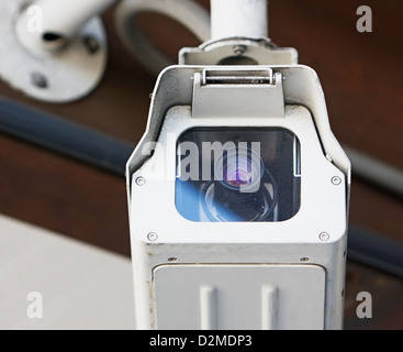 security camera mounted on wall - Stock Image