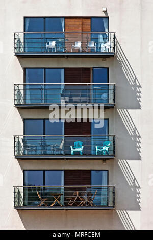 A study in repetition and graphic simplicity - these apartment balconies catch the afternoon sun in Scarborough's North Bay. - Stock Image