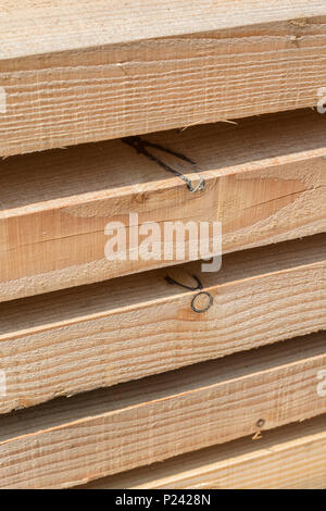Neatly stacked timber planks. - Stock Image