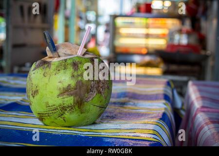 Coconut, Open for a Customer, Kuala Lumpur, Malaysia. - Stock Image