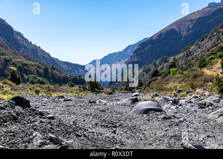 Dried river bed at Barranco de las Angustias, looking away from the main volcanic crater in Caldera de Taburiente National Park, La Palma, Canary Isla - Stock Image