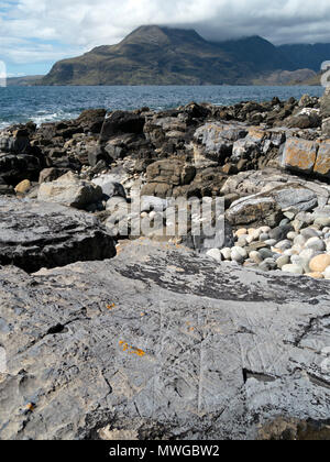 Drift ice abrasion marks on mudstone rock in foreground, Glen Scaladal Bay, Isle of Skye, Scotland UK. For closeups see images MWGBW0 & MWGBW2 - Stock Image