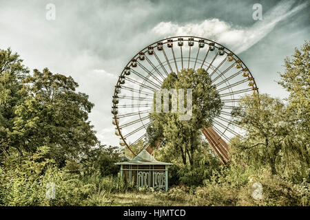Old big wheel in an abandoned amusement park, Spreepark, East Berlin, Treptow, - Stock Image