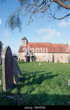 12th century St Mary's church, Binsted, West Sussex, England. Binsted is an ancient village steeped in folklore - Stock Image