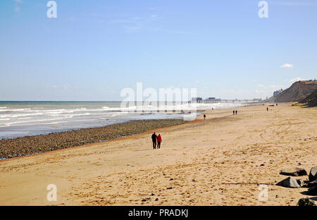 A view looking eastwards along the beach at the North Norfolk seaside village of East Runton, Norfolk, England, United Kingdom, Europe. - Stock Image