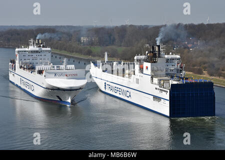 Transfennica sistervessels Kraftca & Trica meeting in the Kiel Canal - Stock Image