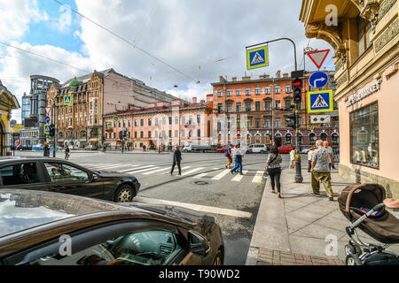 Pedestrians enjoy the afternoon in the urban downtown center of the Baltic city of St. Petersburg, Russia. - Stock Image
