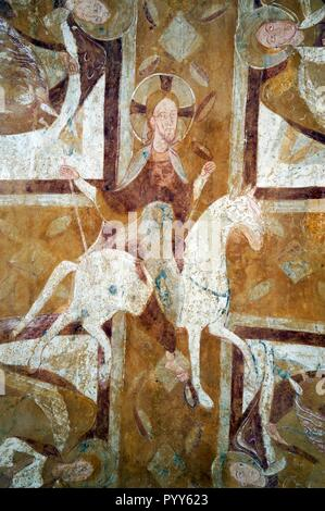 Christ on a White Horse. French Romanesque mural fresco painting on a vault of the crypt, Auxerre Cathedral, France. Circa 1150 - Stock Image
