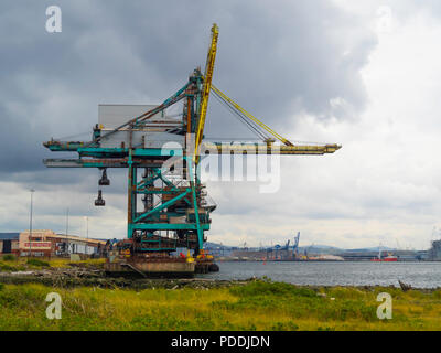 Redcar Bulk Terminal  with a deep water berth on the River Tees and grab cranes for unloading dry cargo from large bulk carrier ships. - Stock Image