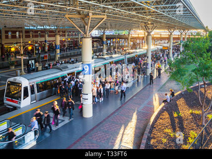Commuters disembarking and boarding a TransPerth train at Perth Train Station - Stock Image