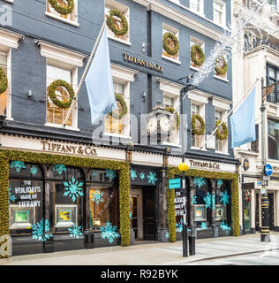 Store front, window display with Christmas decorations, of the Tiffany & Co US upscale jewellery shop in Old Bond Street, Mayfair, London, England, UK - Stock Image