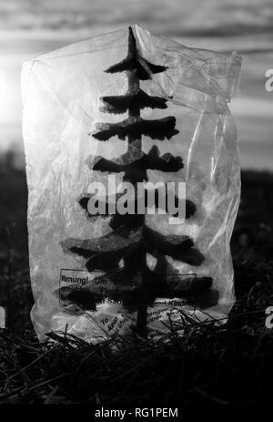 Plastic covered tree - Stock Image