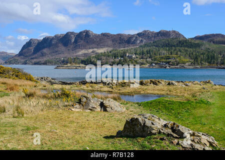 View across Loch Carron to Duncraig Castle and distant crags from Plockton Village, Highland Region, Scotland - Stock Image