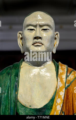 British Museum, Bloomsbury, London, England, UK. Chinese glazed stoneware ceramic- Seated Luohan (disciple of the Buddha) Liao Dynasty (907–1125) - Stock Image