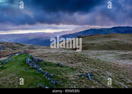 Rain passing through Langdale towards Windermere, seen from Silver How summit, near  Grasmere, Lake District, Cumbria - Stock Image