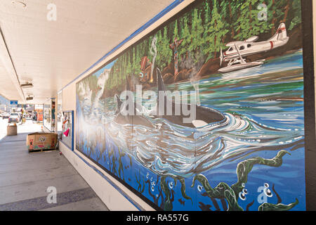 A mural of Orca whales on the side of a building in Petersburg, Mitkof Island, Alaska. Petersburg settled by Norwegian immigrant Peter Buschmann is known as Little Norway due to the high percentage of people of Scandinavian origin. - Stock Image