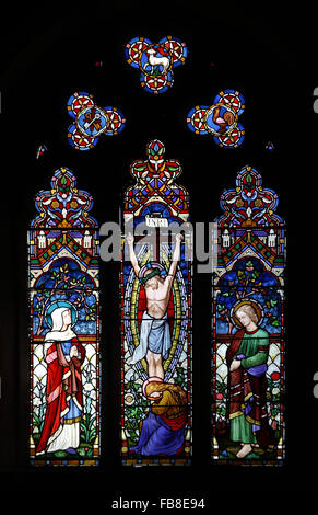 Stained glass window depicting the Crucifixion St Peter's Church, Deene, Northamptonshire - Stock Image