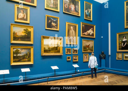 A senior woman viewing  paintings in the Art Gallery at the Bowes Museum Barnard Castle Co.Durham England - Stock Image