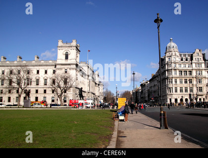 Parliament Square Westminster London Treasury Building on left - Stock Image