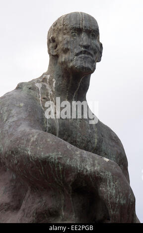 The statue of Jan Smuts in The Company's Garden, Cape Town, South Africa, with a pale sky in the background, - Stock Image