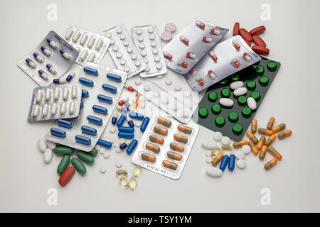 A selection of prescription drugs in blister packs and loose, capsules and tablets - Stock Image