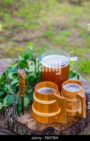 Finnish home brewed malt beer and birch whisk for sauna use - Stock Image