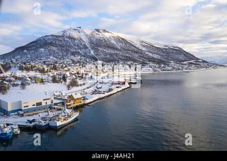 View south from Tromsø bridge (Tromsøbrua) over Tromsøysundet, in the city of Tromsø, Norway. - Stock Image