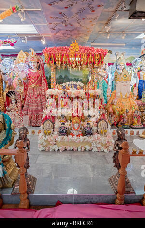 The altar with statues of deities at the DAYARAM MANDIR, a Hindu temple in Jamaica, Queens, New York City. - Stock Image