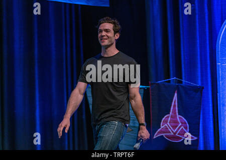 Bonn, Germany - June 8 2019: Ethan Peck (*1986, American actor -  Star Trek: Discovery) speaking at FedCon 28, a four day sci-fi convention. FedCon 28 took place Jun 7-10 2019. - Stock Image