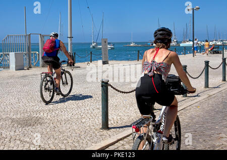 Cyclists on waterfront promenade. Olhao, Algarve, Portugal - Stock Image