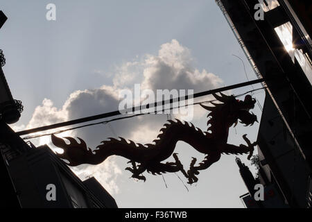 silhouette dragon clouds alley Chinatown - Stock Image
