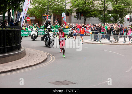 ir Mo Farah (GBR) running through the North Colonnade, Canary Wharf, closely followed by Leul Gebresilasie (ETH), during the 2019 London Marathon. In the men's elite race, Mo went on to finish 5th, in a time of 02:05:39. Leul was 8th, in a time of 02:07:15 - Stock Image