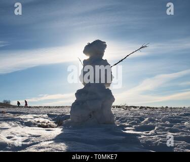 Natural icy snowman. The snow cover the landscape.  Winter time scene. - Stock Image