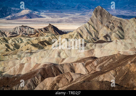 Manly Beacon and badlands, Zabriskie Point, Death Valley National Park, California USA - Stock Image