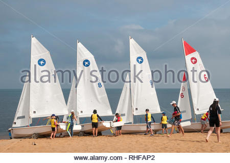 Summer holiday sailing lessons for Australian children underway at Mt Eliza on Port Phillip Bay, Melbourne - Stock Image