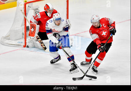 Bratislava, Slovakia. 15th May, 2019. L-R Goaltender Leonardo Genoni (CH), Kristian Forsberg (NOR) and Raphael Diaz (CH) in action during the match between Switzerland and Norway within the 2019 IIHF World Championship in Bratislava, Slovakia, on May 15, 2019. Credit: Vit Simanek/CTK Photo/Alamy Live News - Stock Image
