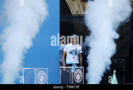Manchester City manager Pep Guardiola walks onstage during the trophy parade in Manchester. - Stock Image