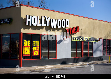 A Hollywood Video movie rental store advertises a going out of business sale in Rogers, Ark. - Stock Image