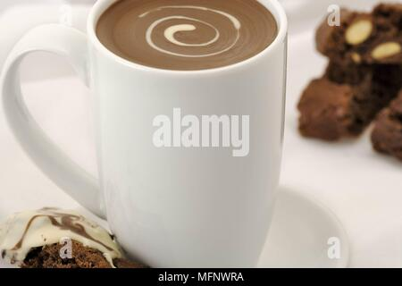 White porcelain cup with drinking chocolate. Almond and chocolate biscoti in background. Studio shot.      Ref: CRB538_103609_0015  COMPULSORY CREDIT: - Stock Image